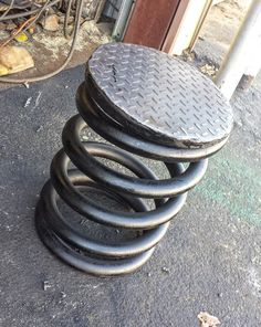Large metal stools perfect for industrial style decor or the man cave, unique one of a kind furniture. Measurements are 20 inches tall x 16 inches wide weight being 180 pounds. Materials in making it are found objects diamond plate and large spring. See more at Recycled Salvage Design