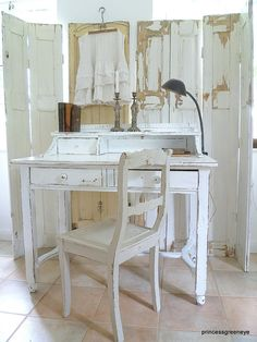 Cottage Chic Home office space. love the shabby old shutters as a room divider screen.