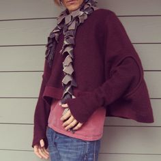 This poncho sweater is made from two felted cashmere sweaters cut apart and pieced back together upside down in some parts.