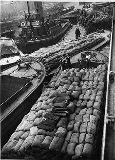 London Docks. Tug Beam and barges 7.7.1940. German prize ship being unloaded.  Maize and Palm kernels.