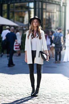 25 winter outfits to copy - white winter coat worn with leather pants, platform ankle boots, a fedora + leather clutch