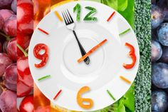 A food clock with vegetables and fruits in the background.: When you eat what you eat makes a difference.