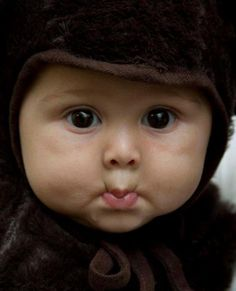 Pucker up! How can you not love these beautiful eyes, rould cheeks and rosebud mouth! God, protect all your precious children!