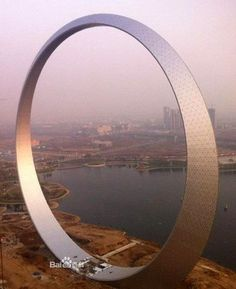 "This round structure named ""the circle of life"" sits in Fushun of Liaoning province, all the way up in China's north. The circular silhouett..."