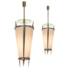 Paolo Buffa for Donzelli: A Pair of Silvered Bronze Lanterns   From a unique collection of antique and modern chandeliers and pendants  at https://www.1stdibs.com/furniture/lighting/chandeliers-pendant-lights/