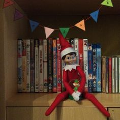 2015 - Day 1: Loki is back! He made mini bunting with 'I'm back' on and brought us a little pressie - a mini elf snow globe #OurElfOnTheShelf #ElfOnTheShelf #Christmas
