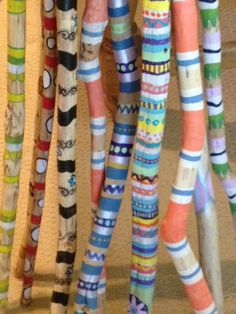 Driftwood walking sticks, painted with acrylics.