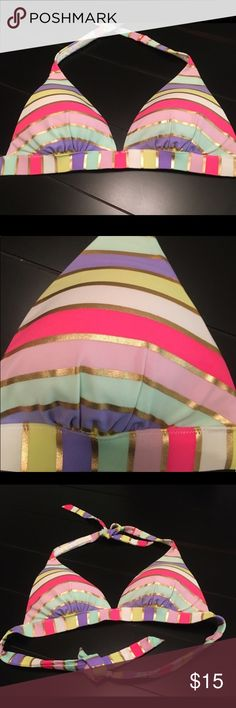 VS Multicolored Striped Bikini Top 🔹Halter Bikini Top 🔹No underwire 🔹Removable Padding 🔹 Tie neck & back 🔹Multi-colored stripes with gold accent stripes 🔹Hand Wash & Line Dry 🔹No Tags  ✨All reasonable offers considered & most accepted through offer button 🚫No Trades  🚫No PayPal Victoria's Secret Swim Bikinis