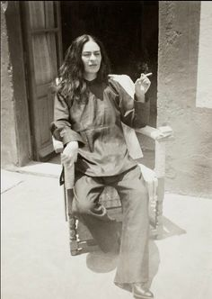"""exhibit at Artisphere. on the back of the photo [translated]:    """"Frida recently operated on in 1946-- Coyoacán -- Frida feeling worse than ever with such intense pain that no one can ever imagine.""""    Photo by Antonio Kahlo, 1946"""