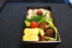 A bento with tofu-ground pork burgers. The blogger says he had tofu-meat burgers with the same mixture for dinner, and made the remaining mixture into meatballs for bento. (Similar recipe using beef is on JustBento.) The bento blog is by a  'divorced gay ex-Lehman management salaryman with a mortgage'!