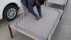 Man Skillfully Weaves a Tightly Strung Charpai Bed
