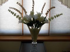 Went to Steins Garden center and bought the silk flowers , bamboo twigs, vase ,then glow in the dark garden rocks.I placed the rocks in first then arranged the flowers and bamboo. The rocks in the vase collects light all day then the entire vase glows at night