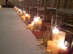 Multiple candles line the aisle- Gorgeous! #enchantedfloristlv