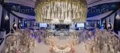 Giant flower chandelier 8m wide above your dinner table. Wedding by Monte-Carlo Weddings.