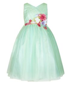 Get garden party-ready with our Jardin tulle dress for girls, bestrewn with colourful flower corsages, and cinched at the waist with a grosgrain ribbon band. Finished with a tie-up bow on the back, this pretty piece is lined in satin for a comfy fit, and features a back zip fastening.