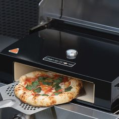 "This fantastic 14"" Bakerstone Box Outdoor Pizza Oven from La Hacienda now makes it possible to create Pizzeria style gourmet pizza in minutes! Thanks to its patent pending design, it converts most thr"