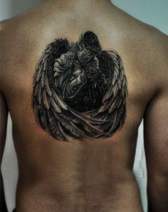 angel tattoo on the back