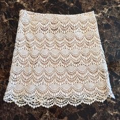 """Forever 21 Crochet Skirt (Small) Forever 21 (Love 21) Ivory Crochet Skirt (with nude lining)! Size Small! Only worn once! Shell: 100% Cotton, Lining: 100% Polyester! Side Zipper! Comes from a very clean, smoke-free, pet-free owner/home! No Trades, No ️️!  Check my closet for any """"on vacation"""" notifications! Bundle and Save!!!! Forever 21 Skirts"""