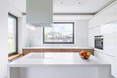 Modern kitchen with white laminate waterfall island white cabinets Waterfall Countertop, Waterfall Island, Laminate Countertops, Kitchen Countertops, Modern Kitchen Design, Kitchen Designs, White Laminate, White Cabinets, Home Decor