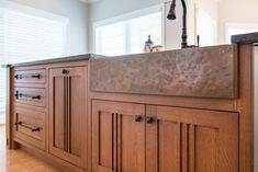A custom hammered copper farmhouse sink in the island blends with the stained quartersawn white oak and coordinates with a hammered copper range hood. Custom Kitchen Cabinets, Kitchen Cabinets In Bathroom, Custom Cabinetry, Leaded Glass Cabinets, Glass Cabinet Doors, Tennessee, Sink Design, Kitchen Design, Small Kitchen Redo