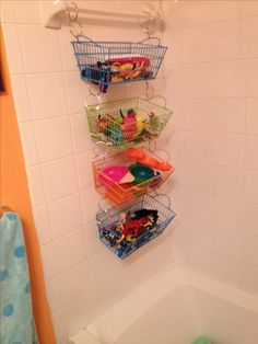 Tub toy organization $5 rubber-coated baskets from 5 below & metal shower curtain hooks from Bed, Bath & Beyond!