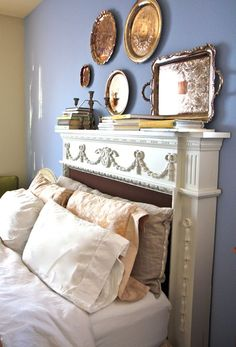 I found this photo on a blog post about cleaning (which I still need to read in depth) but the idea of using a mantle as a headboard was too cool to pass up