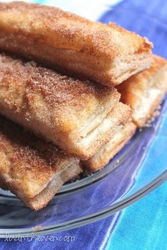Baked Churros....1 sheet frozen pastry puff, thawed  1 cup sugar  1 tablespoon ground cinnamon  1/2 cup melted butter  Preheat oven to 450 degrees.  Cut the frozen pastry into 1 inch wide strips  Bake for 8-10 minutes.  Mix together the sugar and cinnamon.  When they are done baking, brush the sticks with the melted butter and roll into the sugar and cinnamon mixture.