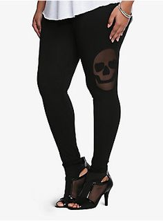 It's time to get your skull fashion fix! Sheer mesh skull heads add a sexy vibe to this edgy black legging. We love it!