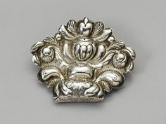 silver cap brooch, part of traditional head dress in Friesland, the Netherlands, about 1830