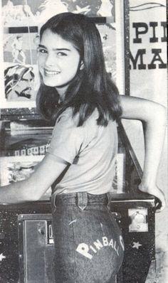 Brooke Shields playing pinball, 1970s.