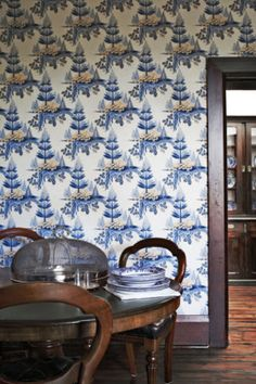 Dining room - I love this amazing wallpaper, the dark wood floors and the table and chairs. Sigh...