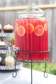 Pink Lemonade Sparkling Punch 4 cans of frozen lemonade concentrate, 1/2 gal of cranberry juice, (1) 46 oz can of red fruit punch Hawaiian punch recommended, 1 qt chilled Ginger Ale, (1) 46 oz can of pineapple juice, 2 lemons (thinly sliced)
