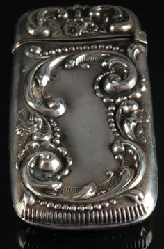 Victorian cast sterling silver Vesta match case with scrolled floral design, hinged lid, marked W sterling along rim.