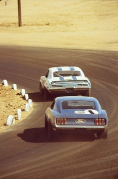 Mission Bell 250 Race Riverside TransAm Jerry Titus in his Pontiac Firebird leads Peter Revson in his Shelby owned Boss 302 Ford Mustang