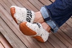 """Free adult crochet slippers pattern makes the perfect quick DIY gift! Free adult crochet slippers pattern and leather sole template from MakeAndDoCrew.com. Made with Lion Brand Wool-Ease Thick & Quick in """"Oatmeal."""" #winteriscoming #wooliscoming"""