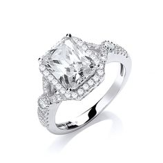 Striking Rectangular cubic zirconia stone surounded by smaller round cubic stones that travel halfway down the shoulders of the ring Types Of Stones, Bridal Jewellery, Gifts For Women, Jewelry Gifts, Charity, Wedding Rings, Engagement Rings, Sterling Silver, Enagement Rings