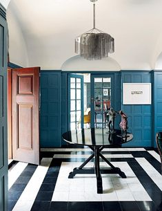 A heritage home in the historic Johannesburg suburb of Westcliff has been given fresh life for the next generation via a sensitive restoration. Blue Hallway, Entrance Table, Interior Design Process, Modern Entrance, Space Frame, Interiors Magazine, Change, Interior Photography, Home