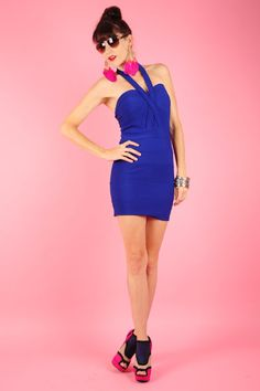 Make A Wish  $38.91  Sexy Criss Cross Halter Bandage Dress with Zipper Closure in the Back.   100% Polyester.  www.ClassyChickClothingOnline.com