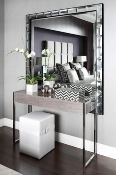 Modern console table with soft colors, for a contemporary interior.