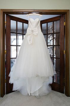 Cosmobella wedding dress with a bow