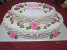 Going Away Cake - top layer is strawberry, bottom layer is chocolate, buttercream basketweave, royal icing roses and daises.