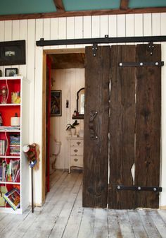 Reclaimed Wood Door. We've fallen for barn doors.