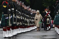 Britain's Queen Elizabeth inspects soldiers from the Royal Regiment of Scotland, during the Ceremony Of The Keys at Holyrood Palace in Edinburgh, Scotland