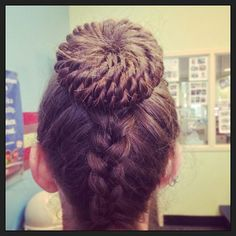 Thick reverse braid into a curly bun