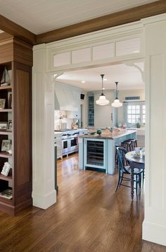 Small Shingle Beach Cottage Design: Transom windows and corbels make this kitchen feel even more special. Floors are Red Oak.