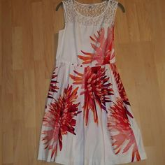 >Studio One New York Spring Dress White with floral design of coral, reds. I found a crop cardigan that matched perfectly size large in coral.  I will include with the dress it compliments it so well. ? Studio One New York  Dresses Midi