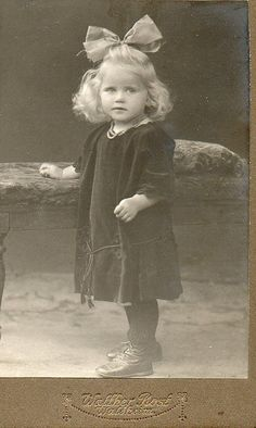 +~+~Antique Photograph~+~+  Cutie in black velvet with large head bow.