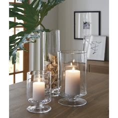 A Crate and Barrel classic, these handcrafted glass hurricanes, look as beautiful reflecting candlelight as they do filled with twinkling garlands or terrarium plantings. Dining Room Centerpiece, Dining Room Table Centerpieces, Dinning Room Tables, Decoration Table, Centerpiece Ideas, Dinning Table Decor Ideas, Kitchen Island Centerpiece, Candle Centerpieces, Vases Decor