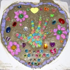 See a picture of a home-made garden stepping stone submitted by Stacy Johnson. It features stones, beads, and handprints.