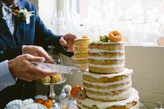 Two grooms cake cutting // Emily Elizabeth Events + A love supreme photography + Pretty Flowers Maine + Nothing Bakes Like a Parrott + Joseph's + Mizu